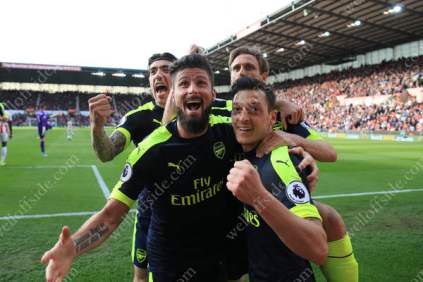 Mesut Ozil of Arsenal (R) celebrates with teammates Olivier Giroud of Arsenal (2L), Hector Bellerin (L) and Nacho Monreal (2R) after scoring their 2nd goal