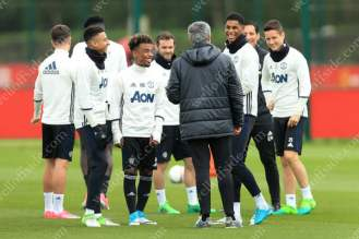 Man Utd manager Jose Mourinho (C) shares a laugh and a joke with Angel Gomes (L) and Marcus Rashford (R)