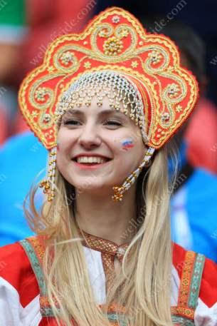 A Russian fan in traditional dress