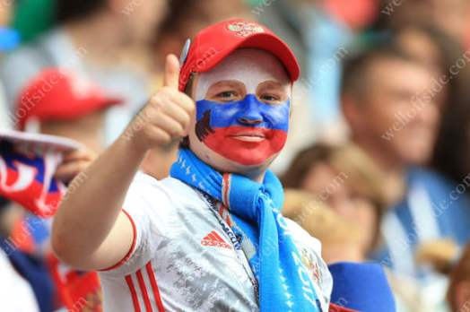 A Russian fan gives the thumbs-up