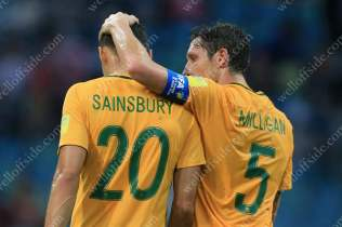 Mark Milligan of Australia (R) consoles dejected teammate Trent Sainsbury