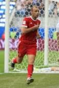 Denis Glushakov of Russia celebrates after scoring their 1st goal