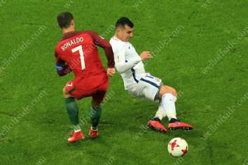 Gary Medel of Chile tackles Cristiano Ronaldo of Portugal