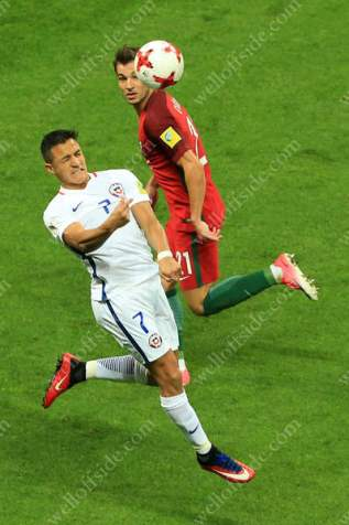 Alexis Sanchez of Chile battles with Cedric Soares of Portugal