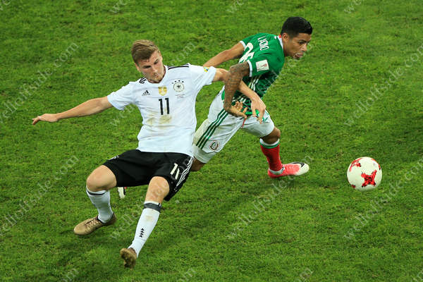 Timo Werner of Germany battles with Javier Aquino of Mexico