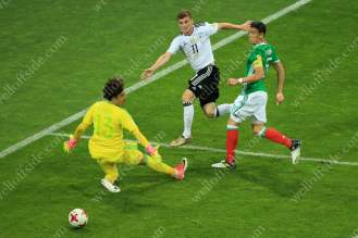 Timo Werner of Germany shoots past Mexico goalkeeper Guillermo Ochoa