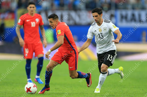 Alexis Sanchez of Chile battles with Lars Stindl of Germany