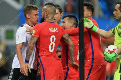 Arturo Vidal of Chile squares up to club teammate Joshua Kimmich of Germany