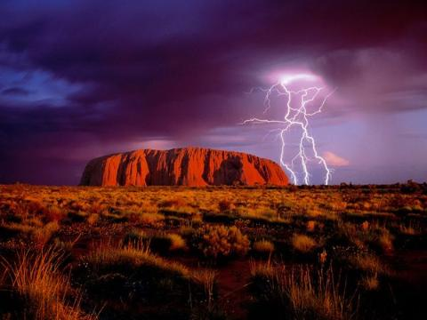 Ayers Rock. I'd quite like to see it, preferably by teleporting there rather than flying