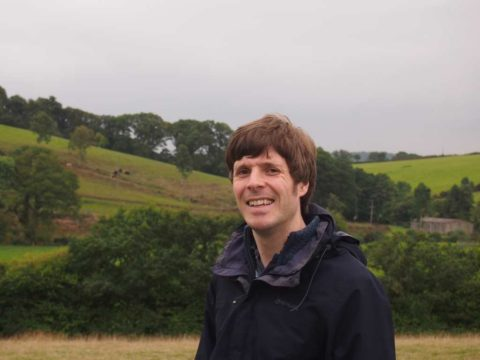 Andy from liberate.life with the rolling Devon countryside in the background