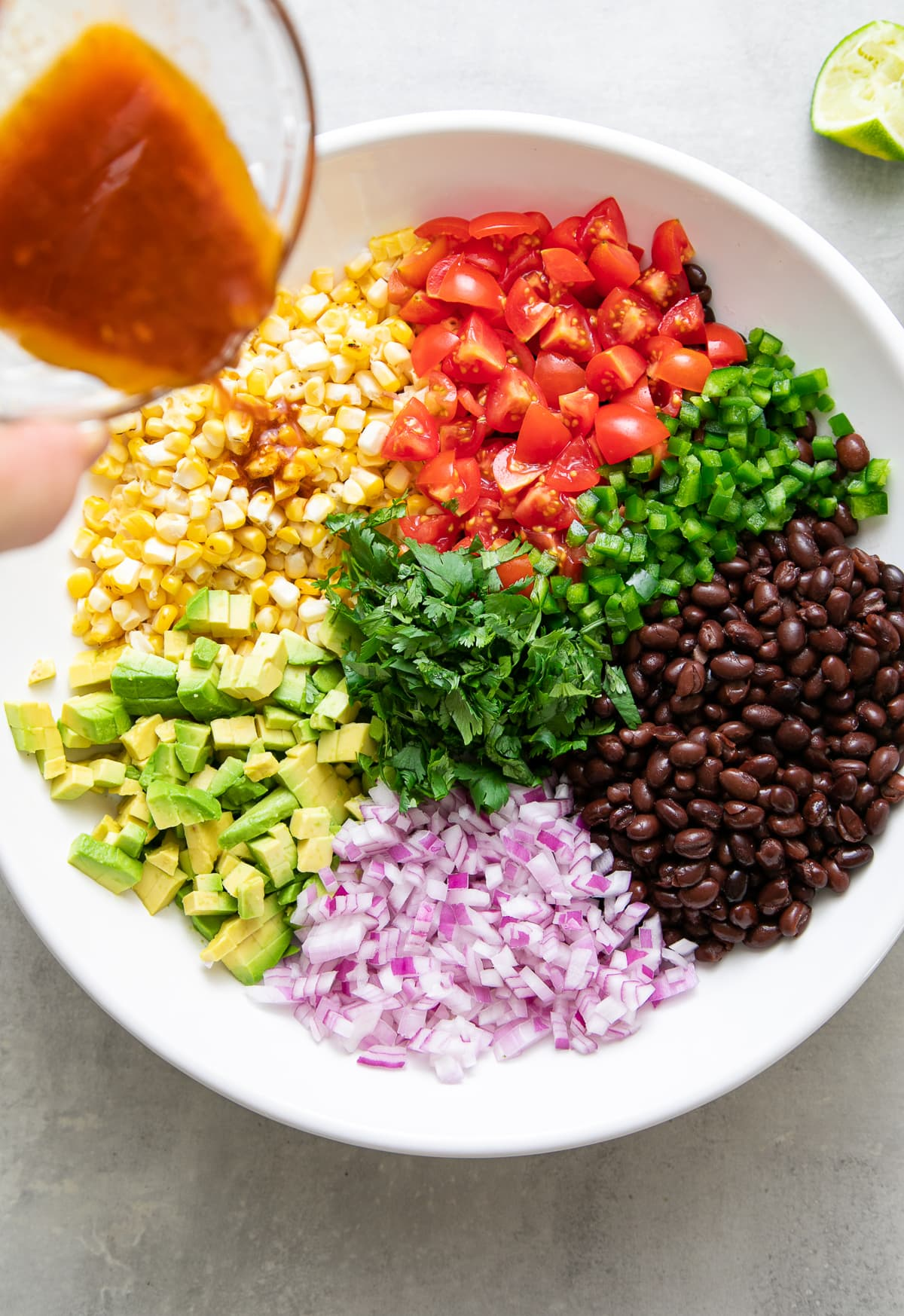 top down view showing the process of making black bean corn salad recipe.