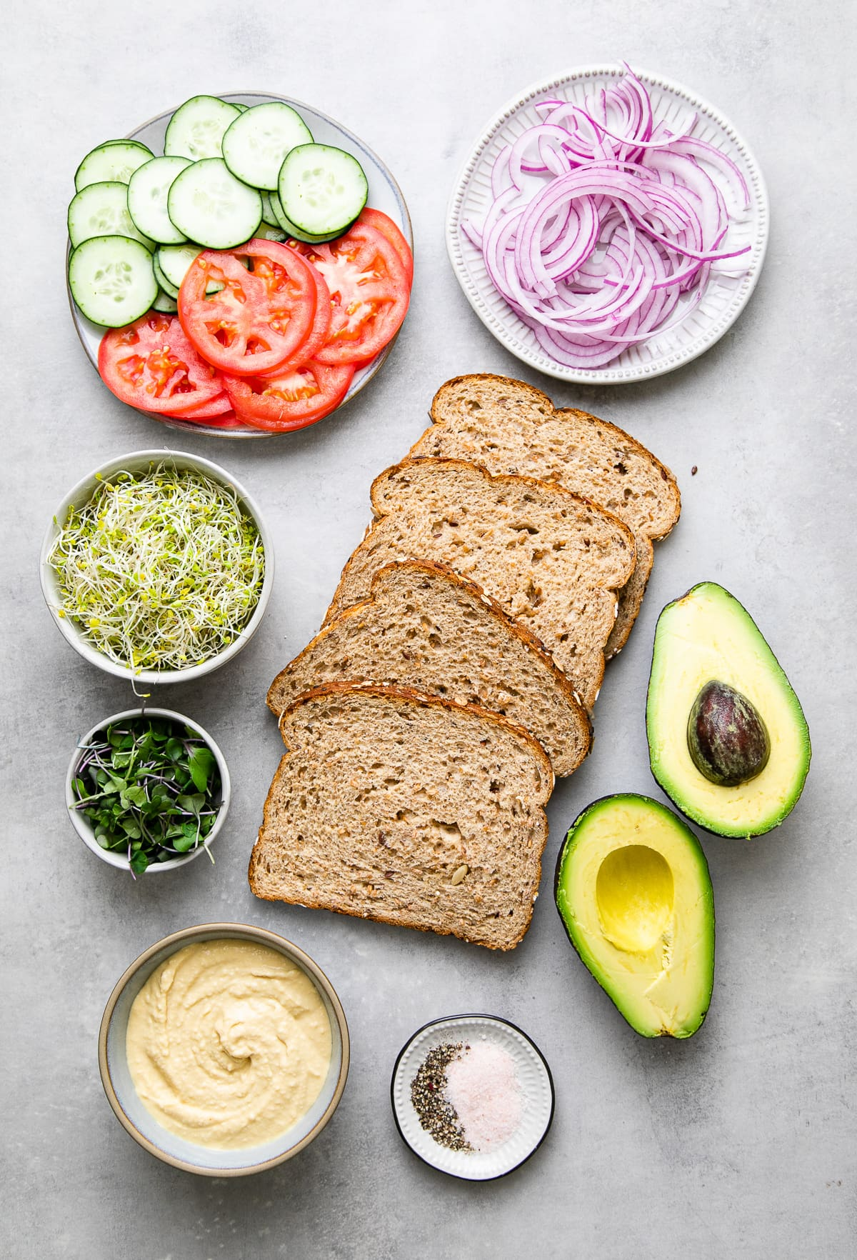 top down view of ingredients used to make healthy hummus veggie sandwich.