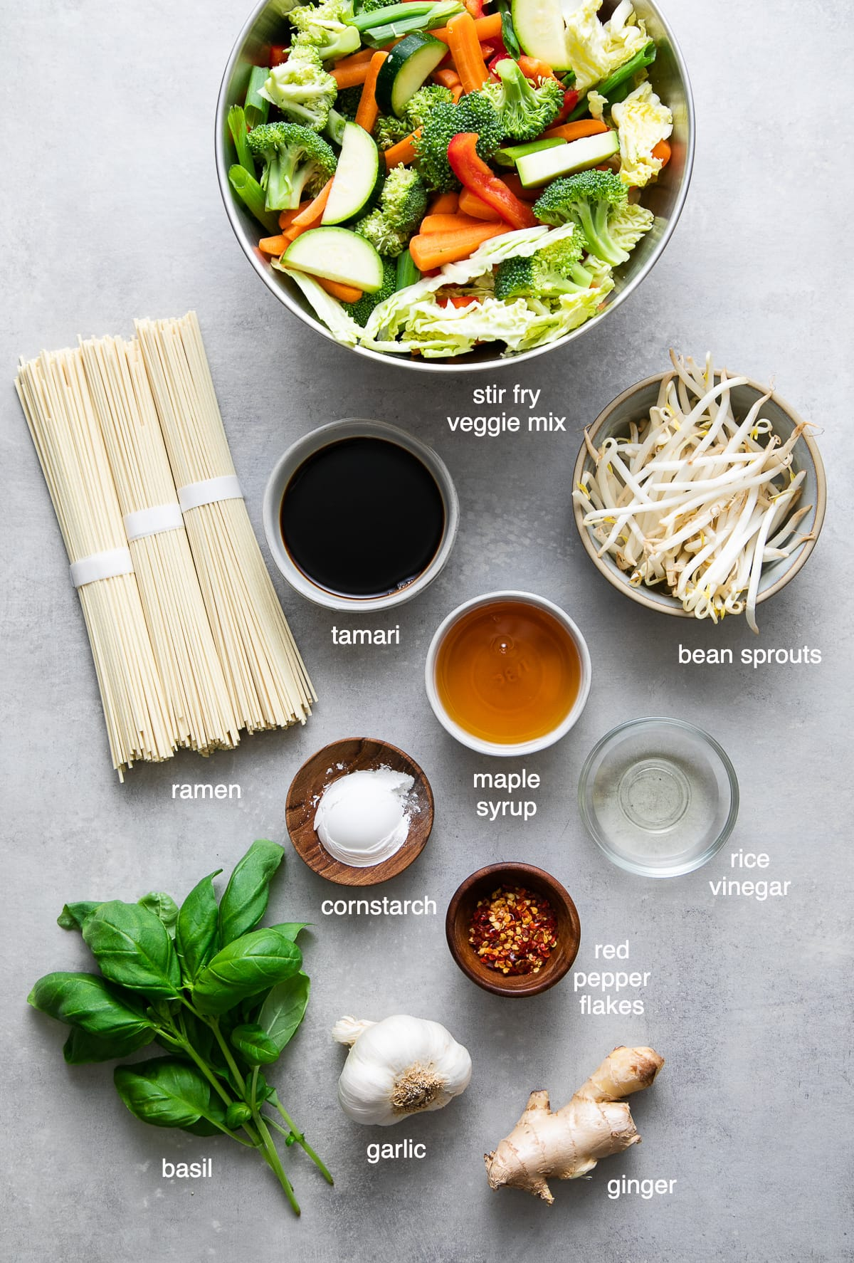 top down view of ingredients used to make ramen noodle stir fry recipe with veggies.