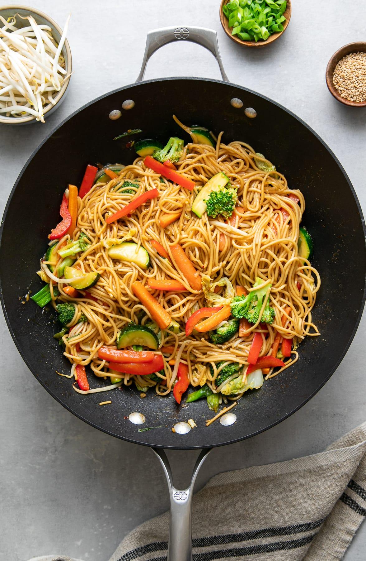top down view of freshly made veggie ramen stir in a wok.