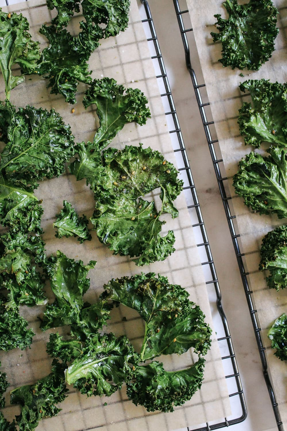 crispy baked kale chips cooling on a wire rack