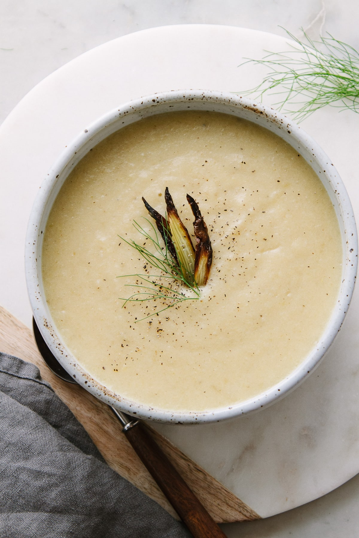 top down view of a bowl full of roasted fennel and potato soup.