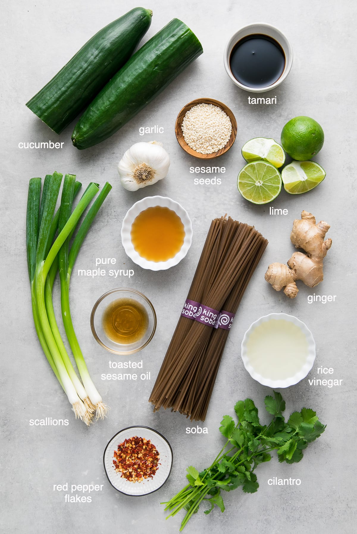 top down view of ingredients used to make sesame-ginger scallion soba noodle salad with cucumbers.