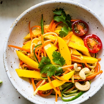 top down, up close view of bowl with a serving of spicy thai mango salad