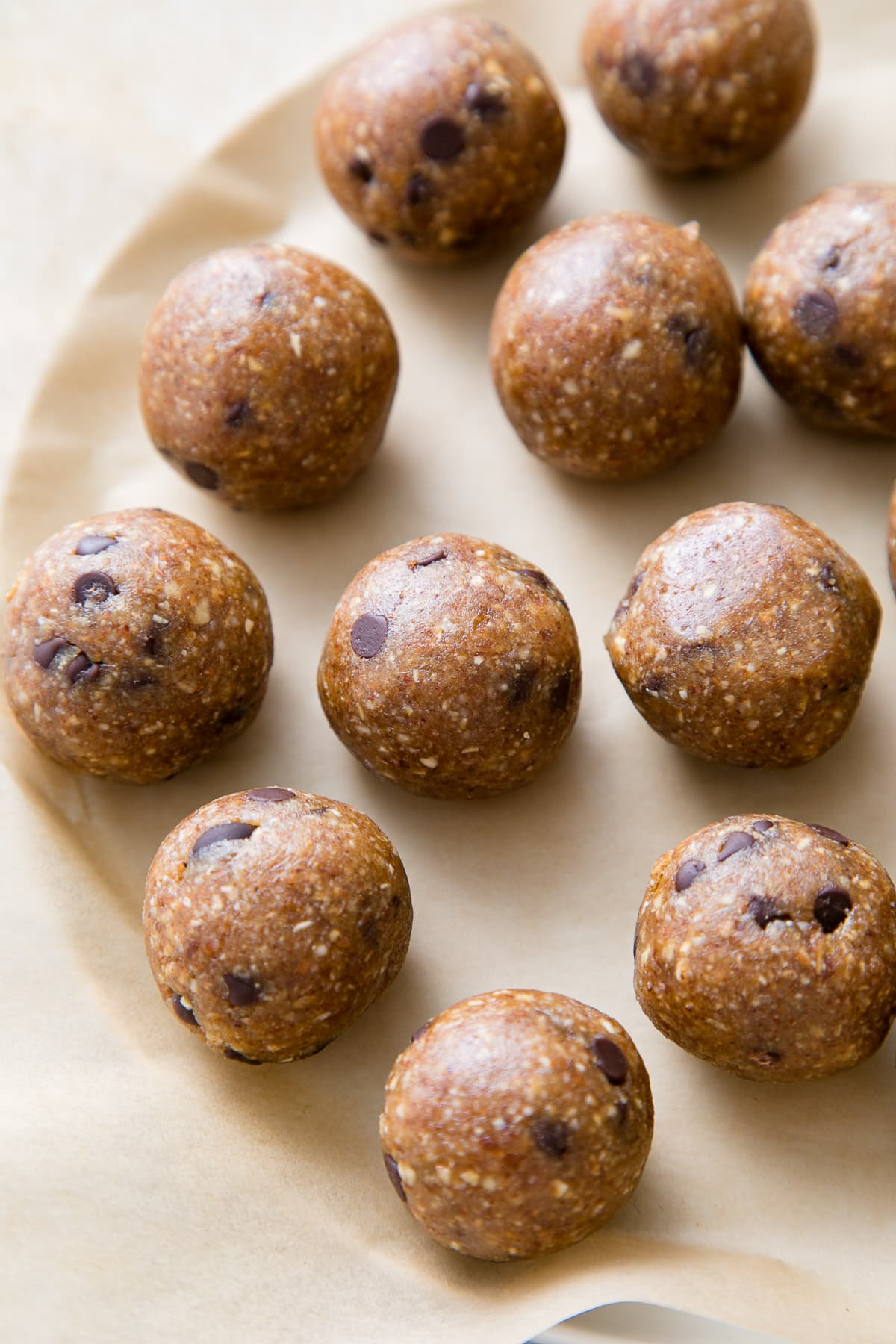 side angle view of chocolate chip energy bites on plate.