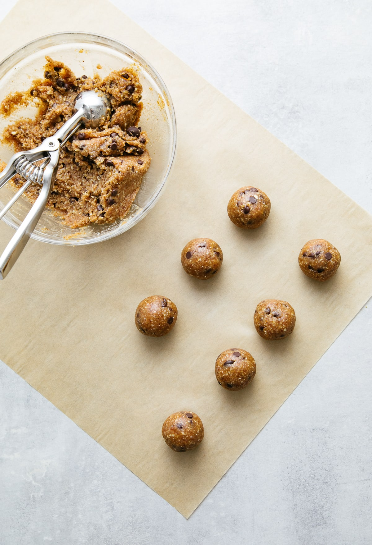 top down view showing the process of rolling chocolate chip energy bites.