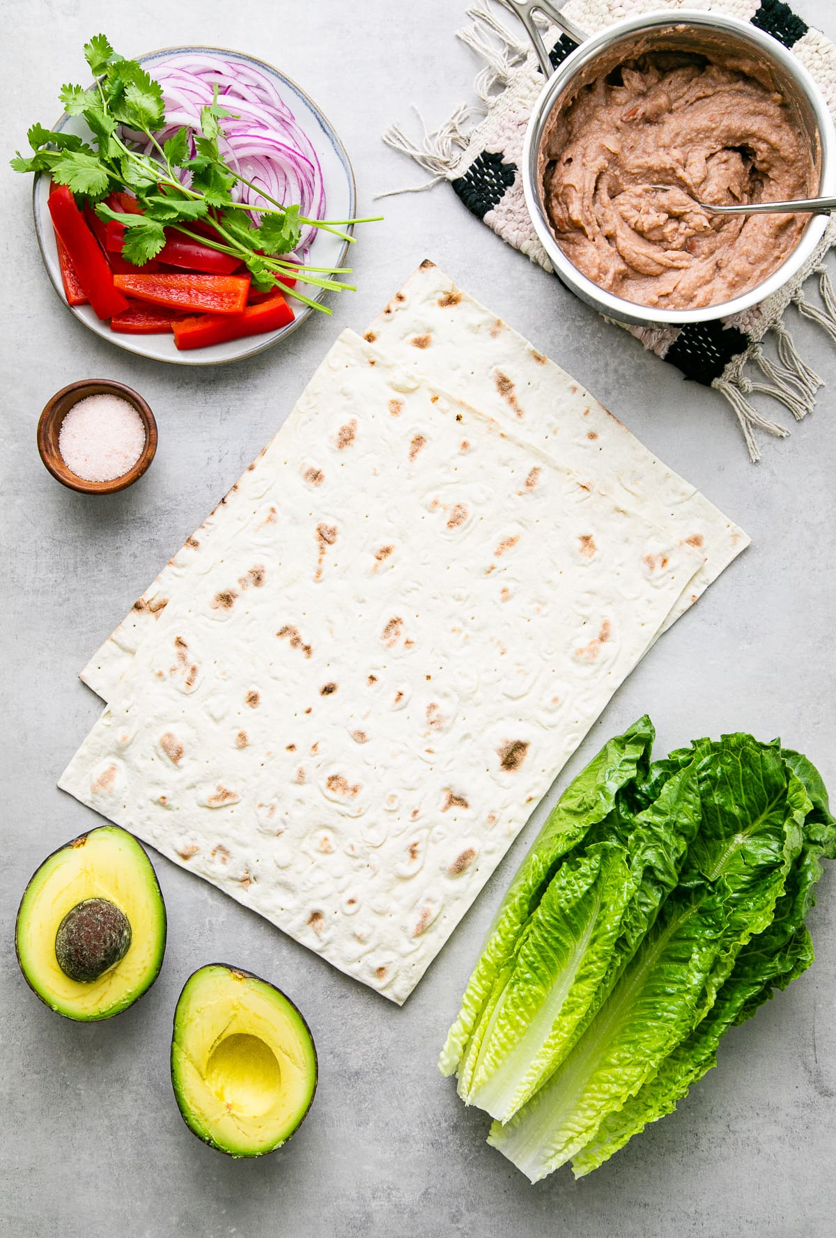 top down view of ingredients used to make refried bean avocado lavash wraps.