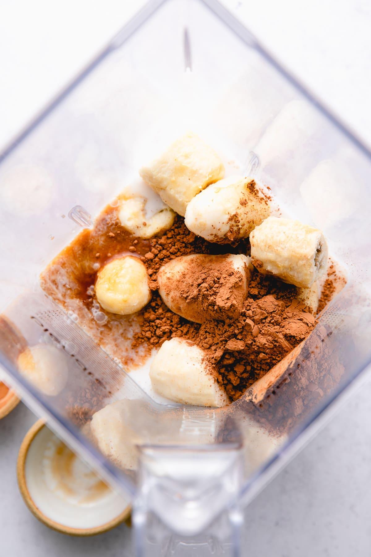 top down view of ingredients used to make healthy vegan chocolate milkshake recipe.