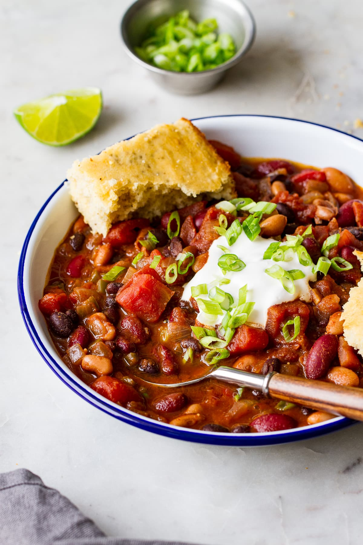 side angle view of a bowl full of quick and easy three bean chili.