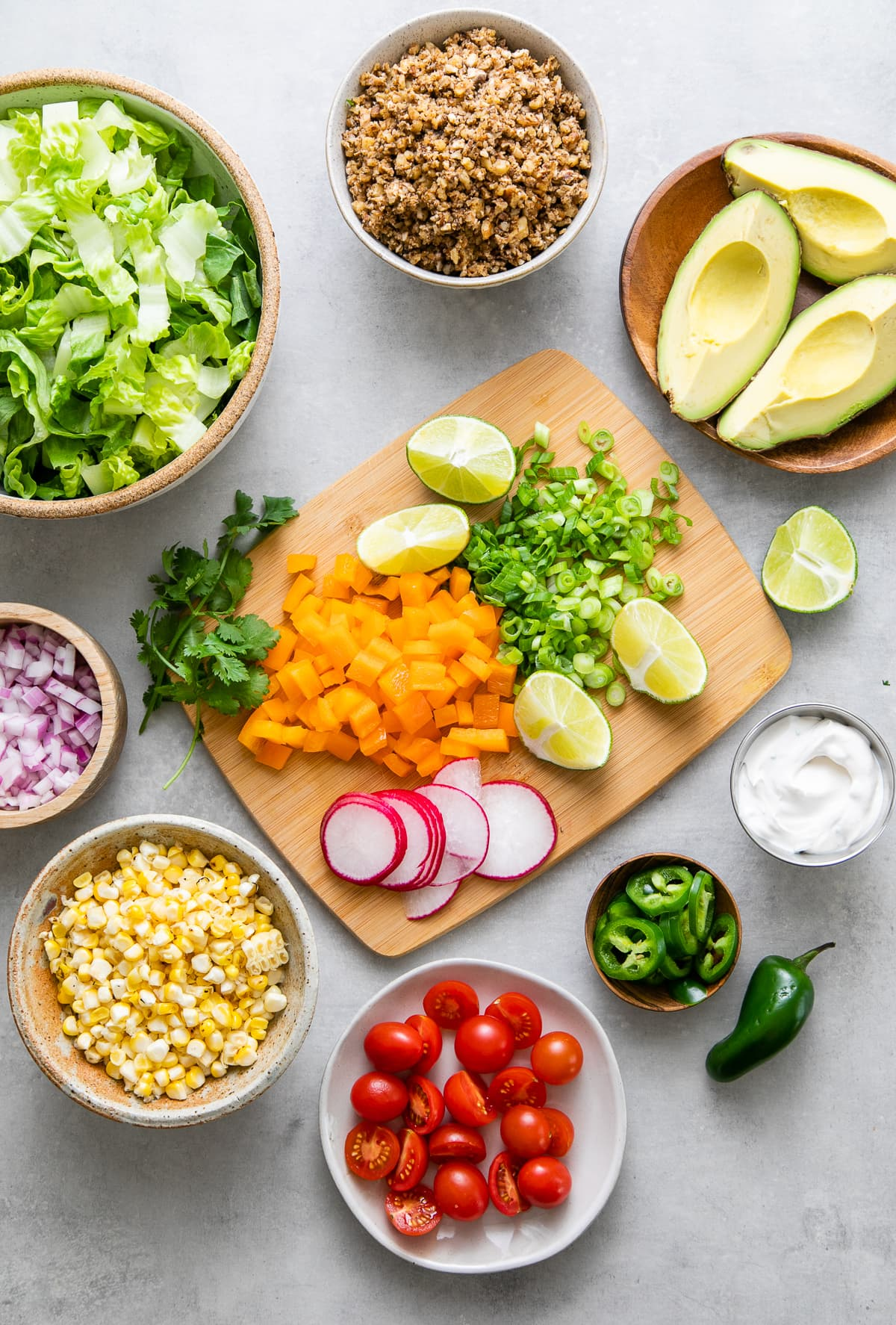 top down view of ingredients used to make the best vegan taco salad with healthy walnut taco meat.