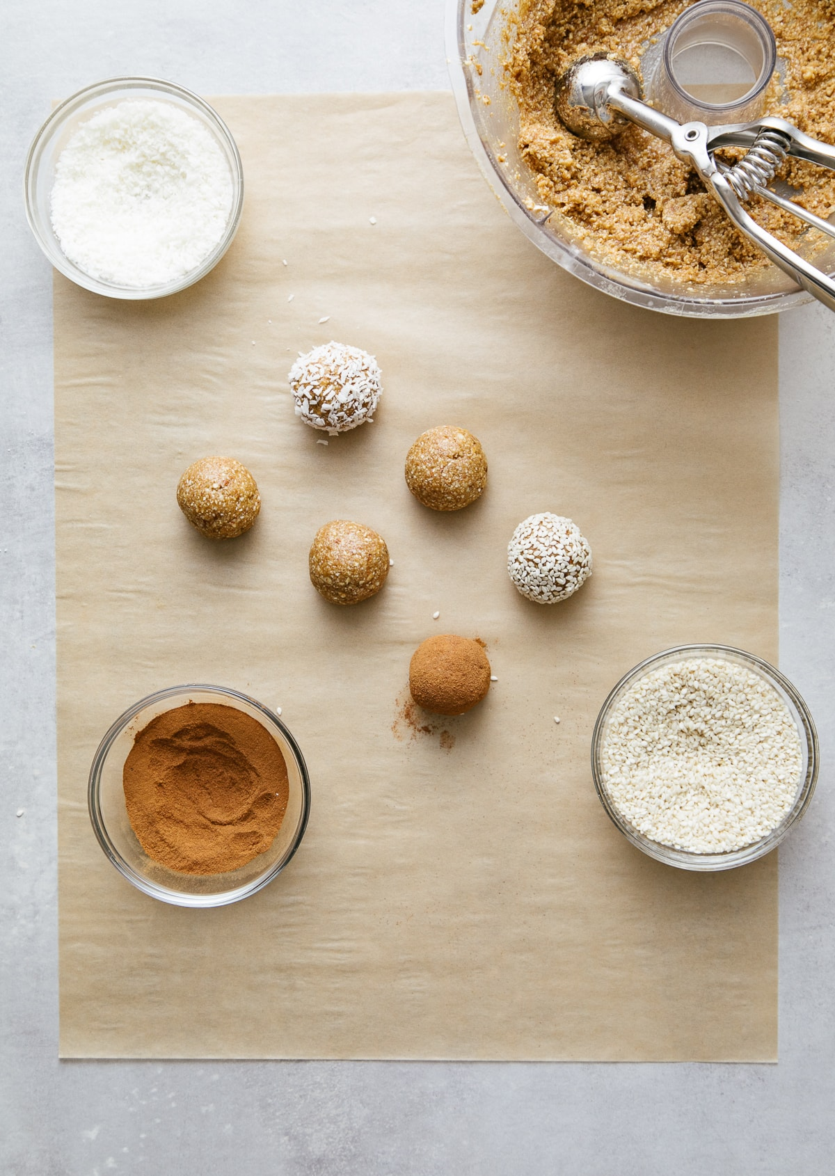 top down view showing the process of rolling raw ginger snaps.