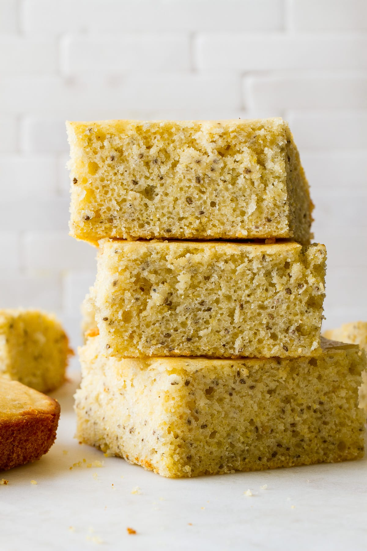 head on view of slices of vegan cornbread stacked.