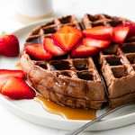 head on view of vegan chocolate belgian waffle on a plate.