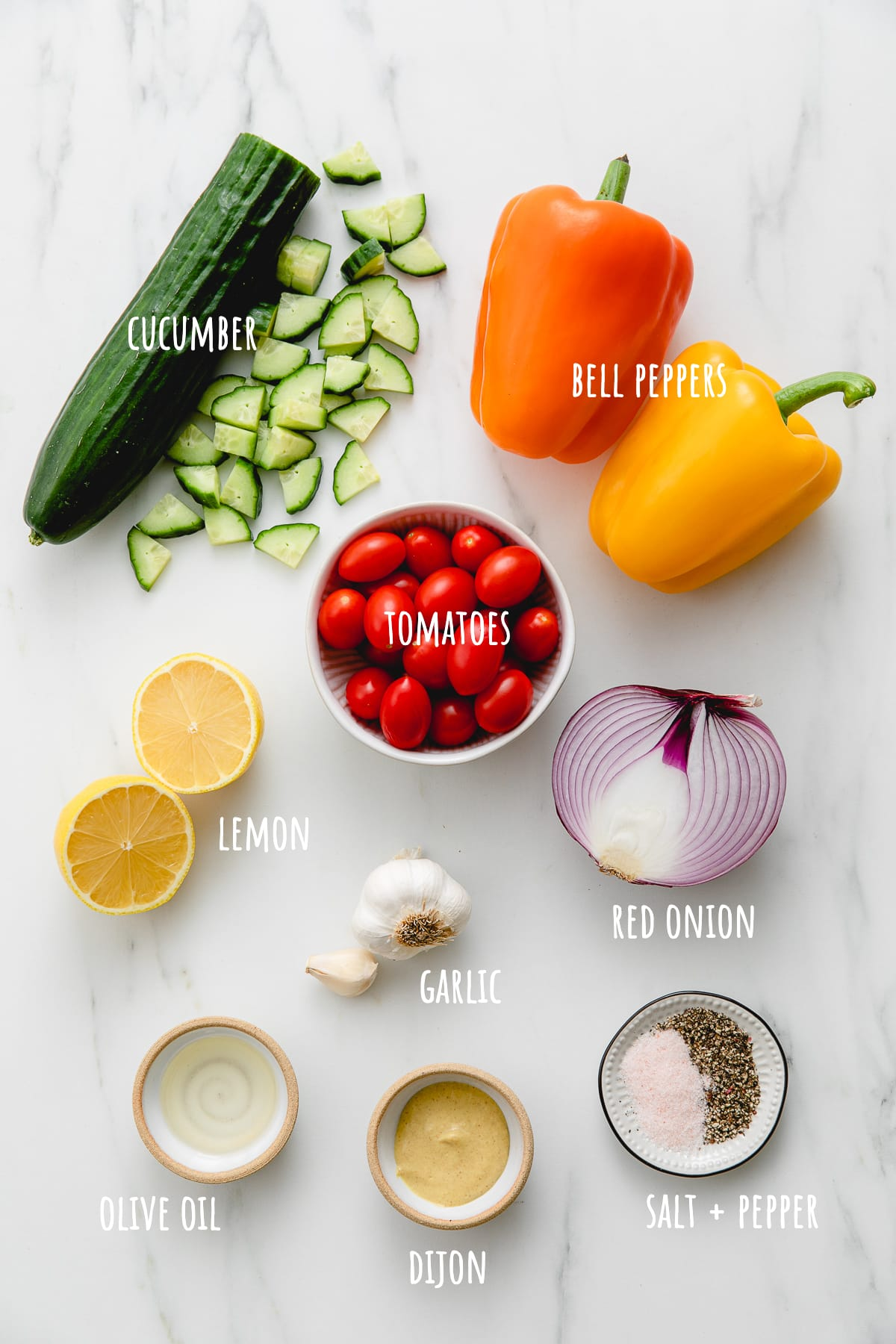 top down view of ingredients used to make chopped vegetable salad recipe.