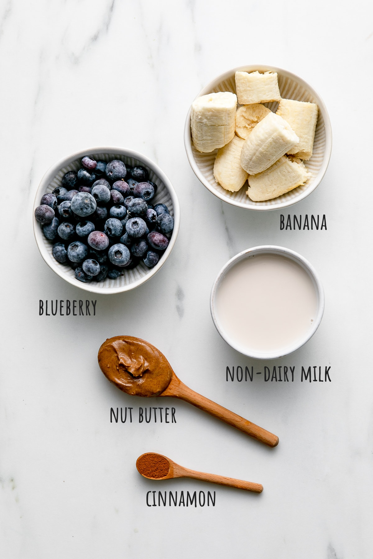 top down view of ingredients used to make blueberry banana smoothie recipe.