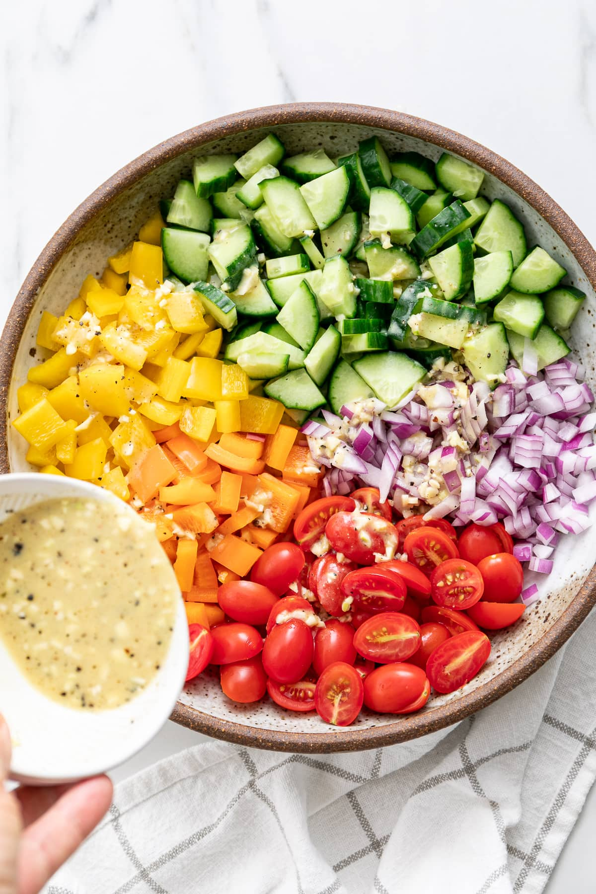 top down view of ingredients added to bowl and dressing poured over top.