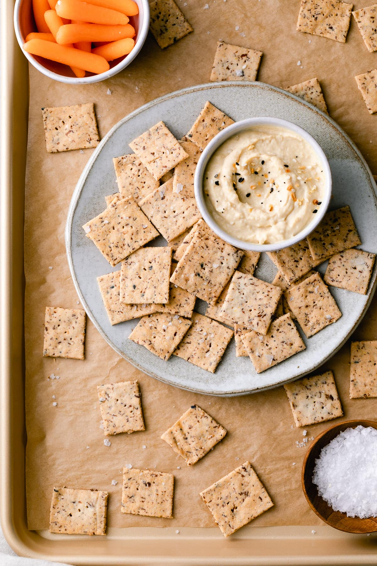 top down view of almond flour crackers on a plate with items surrounding.