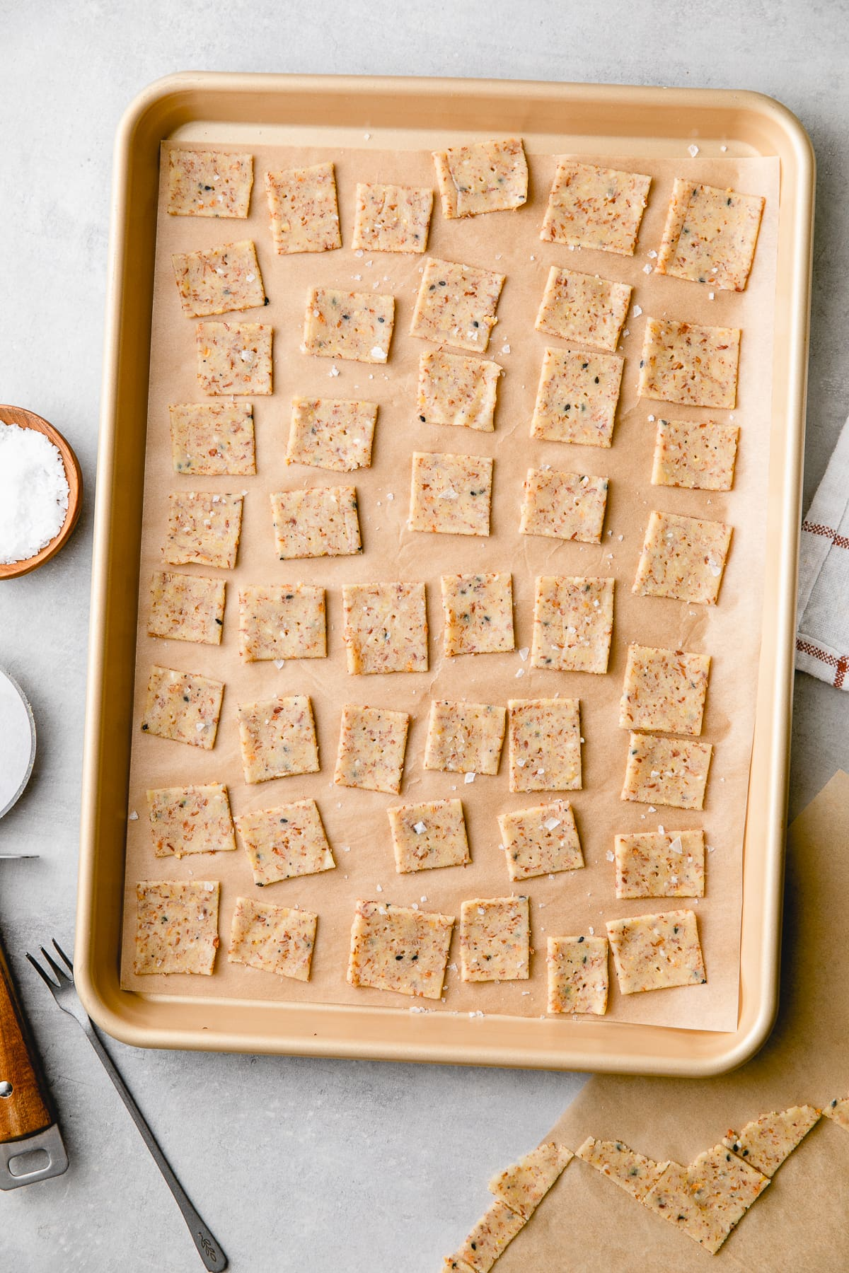 top down view of grain free almond flour crackers ready for the oven on a baking sheet.