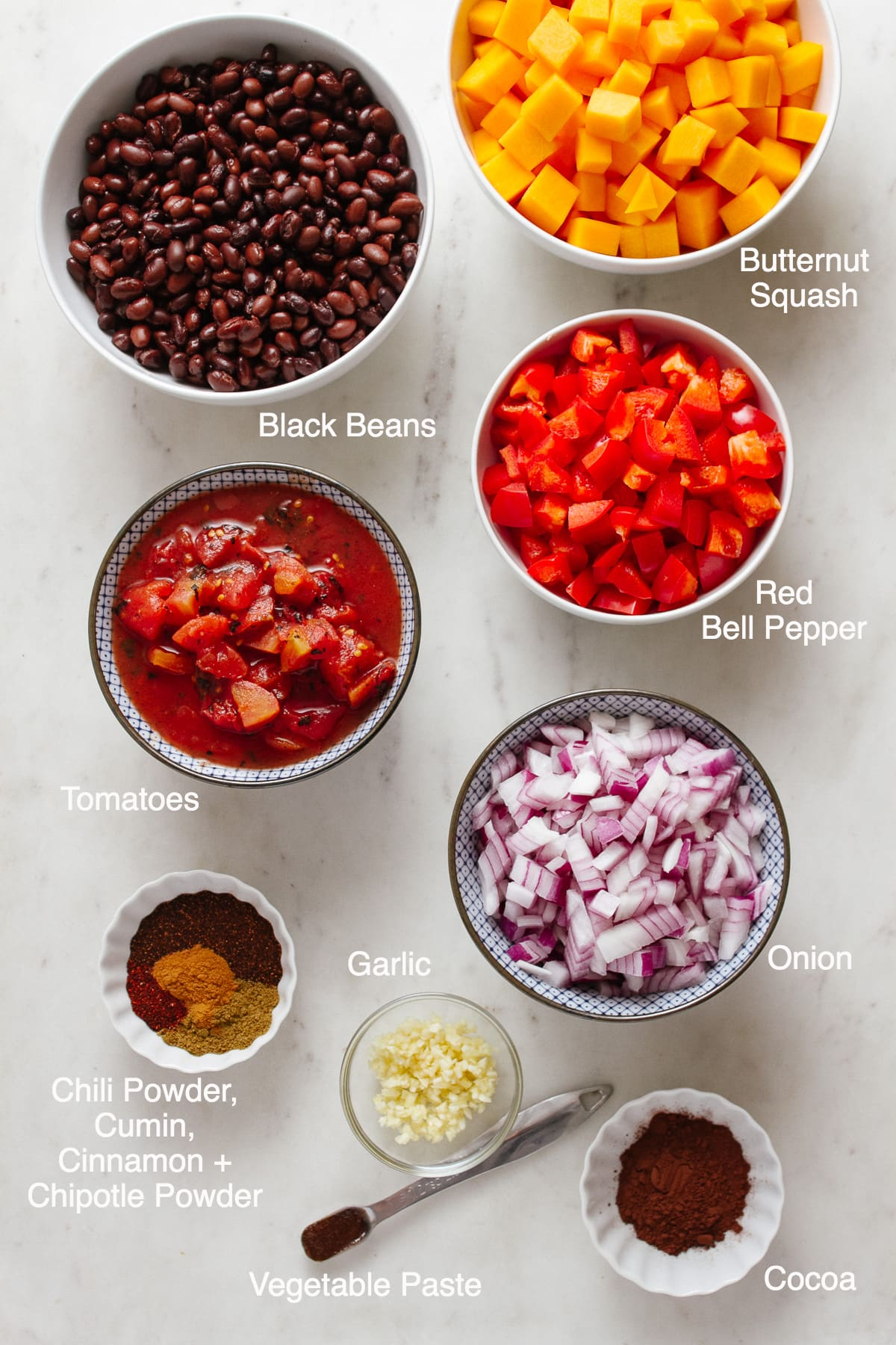 top down view of ingredients needed to make vegan butternut squash chili with black beans.