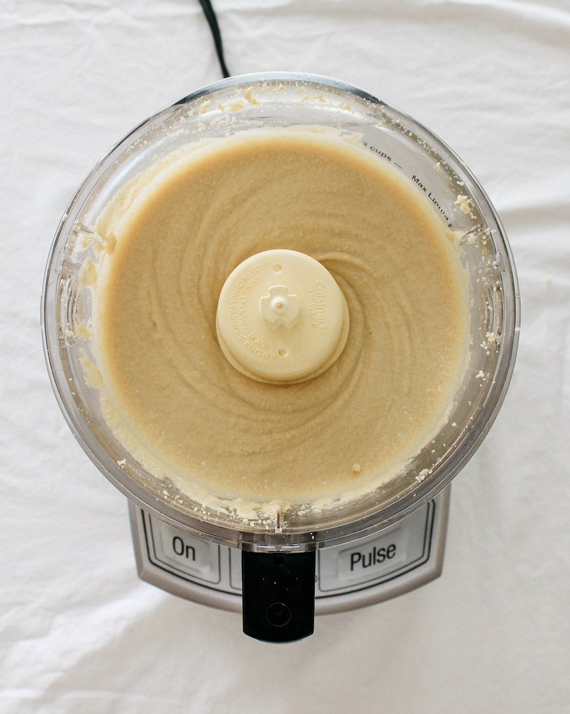 top down view of sesame seed made into a paste after 7 - 10 minutes, making tahini.
