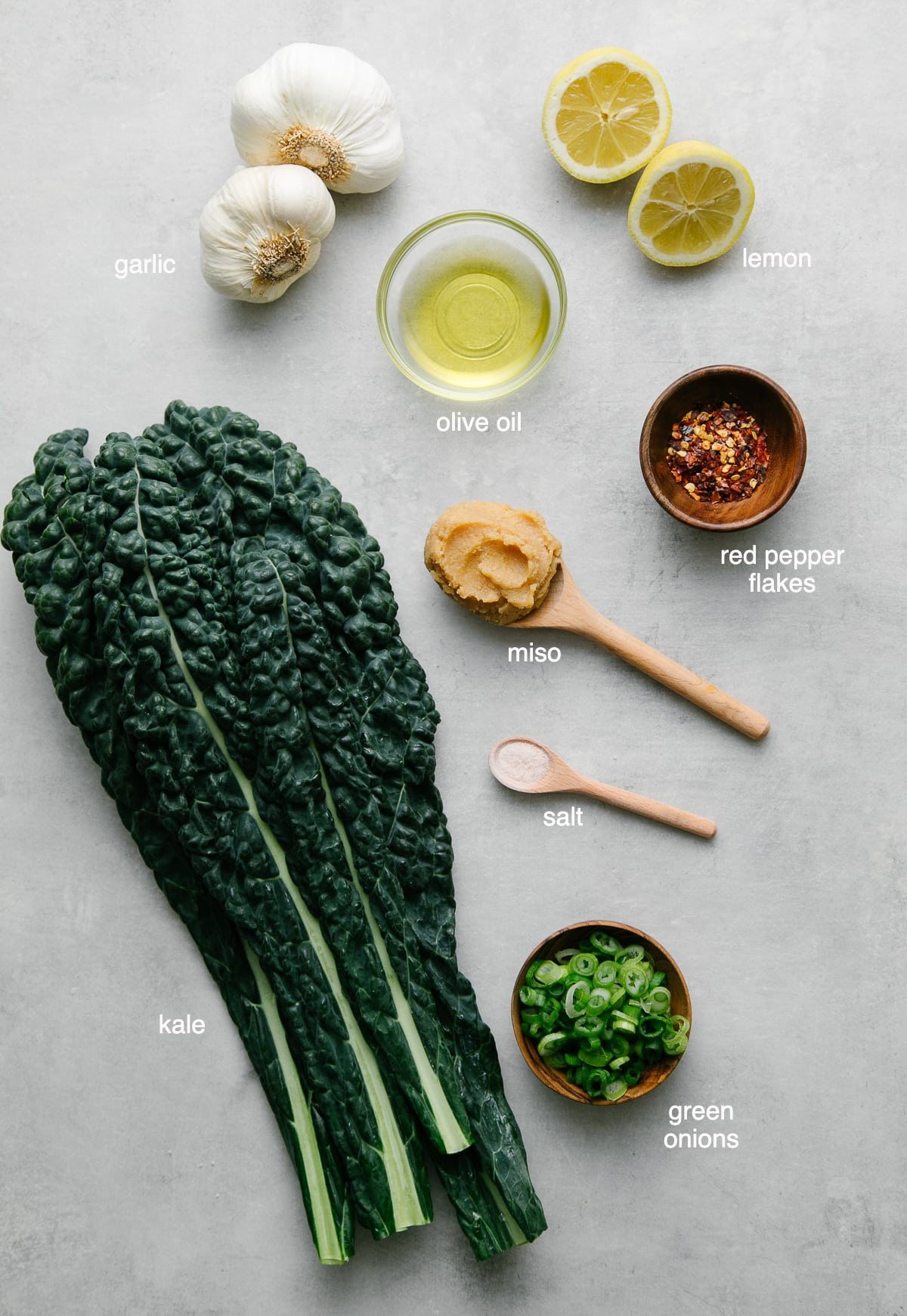 top down view of ingredients used to make vegan miso soup with garlic and kale.