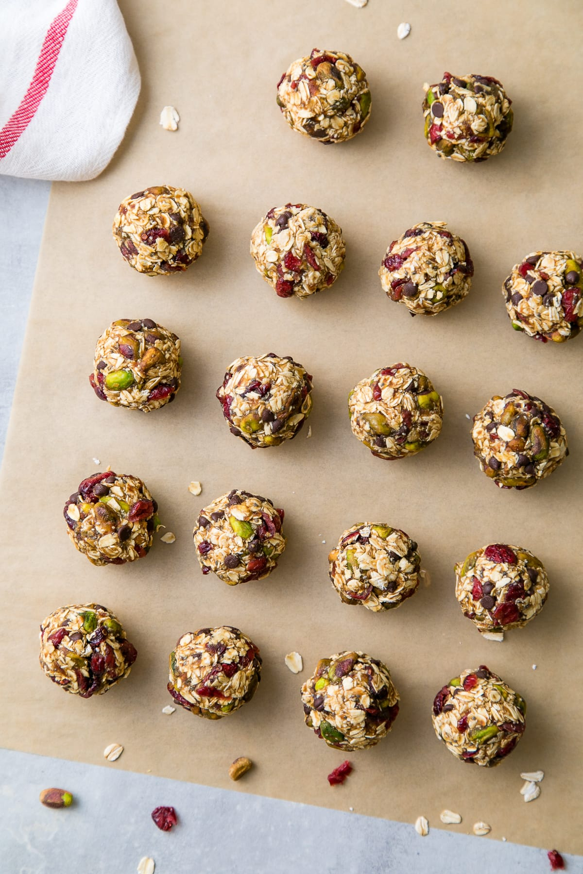 top down view of freshly rolled oatmeal energy bites with pistachios and cranberries.