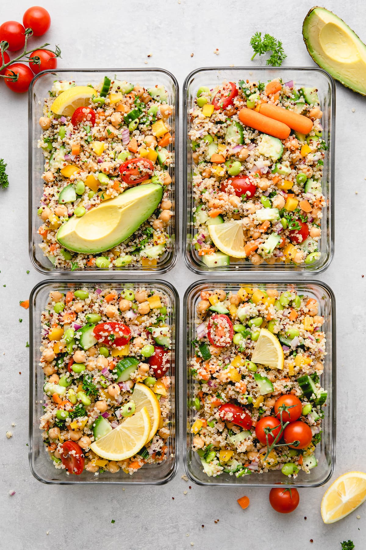 top down view of meal prepped vegan quinoa salad in glass containers.