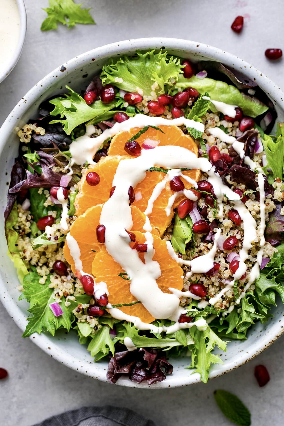 top down view of winter salad with items surrounding.