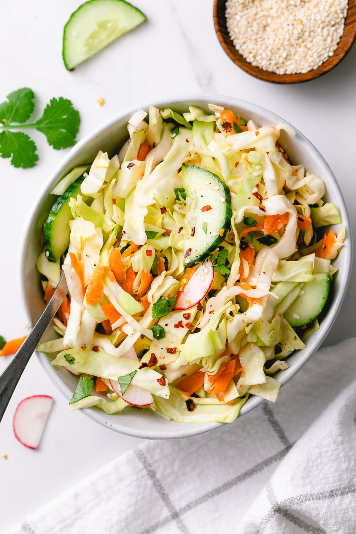 top down view of small bowl with healthy cabbage salad.