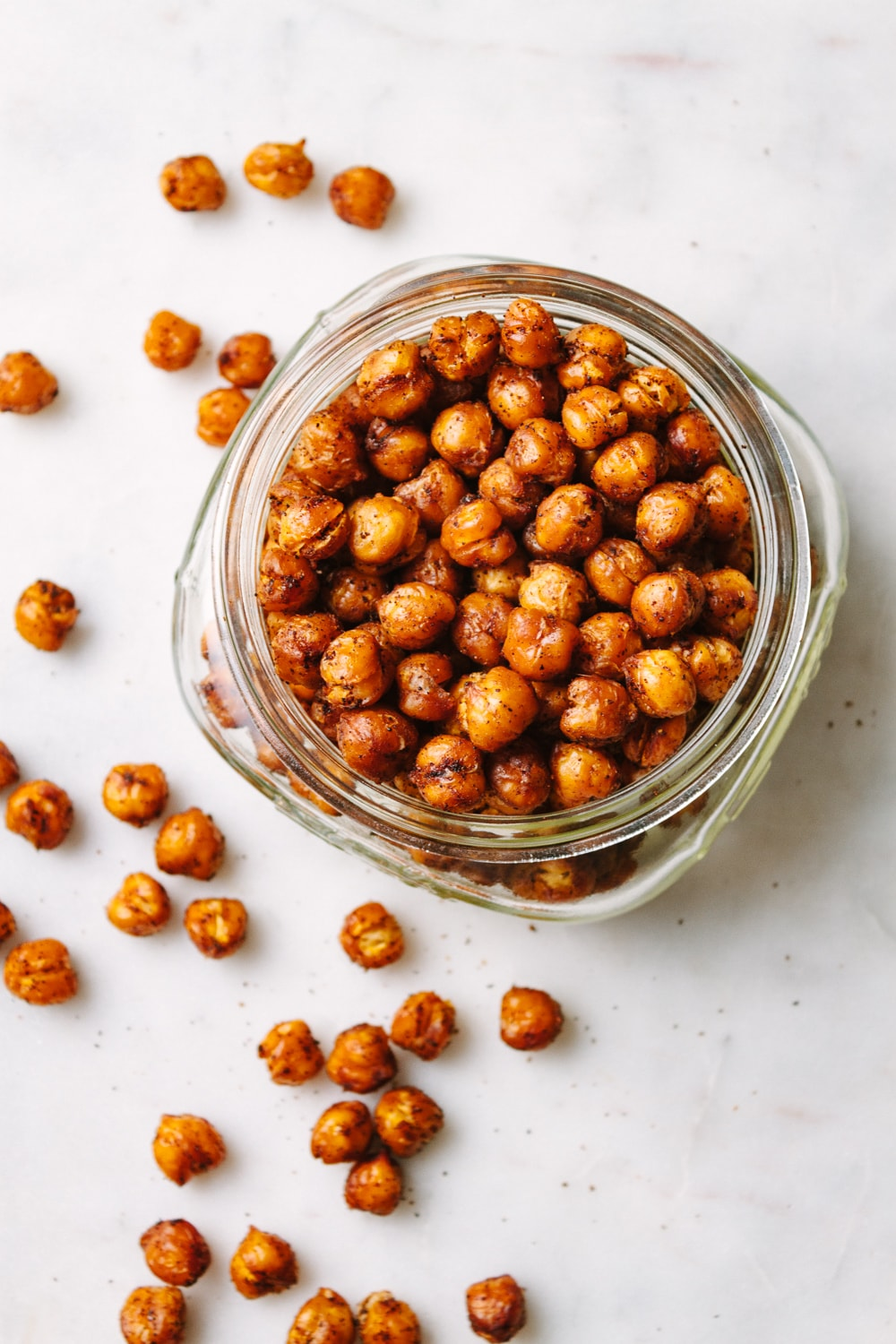 top down view of a glass jar filled with chipotle roasted chickpeas.