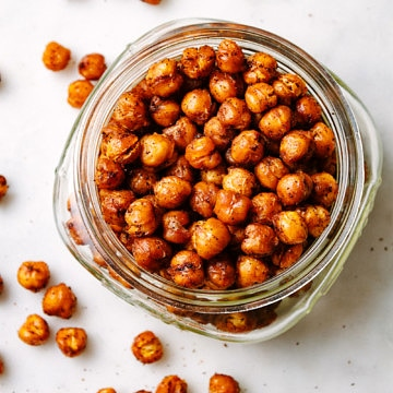 top down view of roasted chipotle chickpeas in a jar.