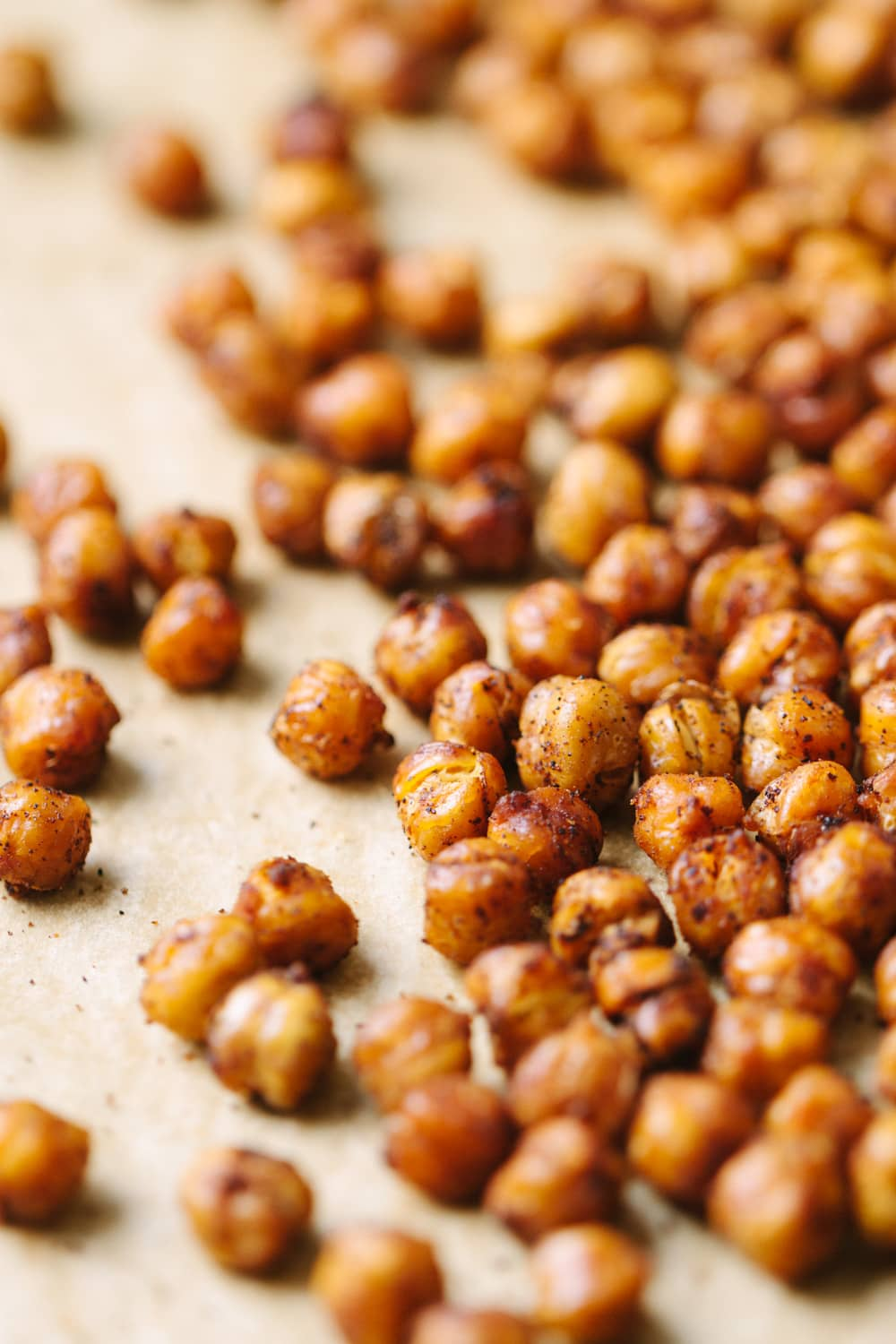 spicy chipotle roasted chickpeas on a baking sheet fresh from the oven