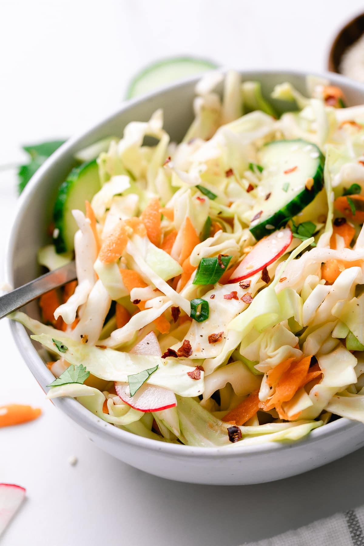 side angle view of small bowl with oil-free cabbage salad.