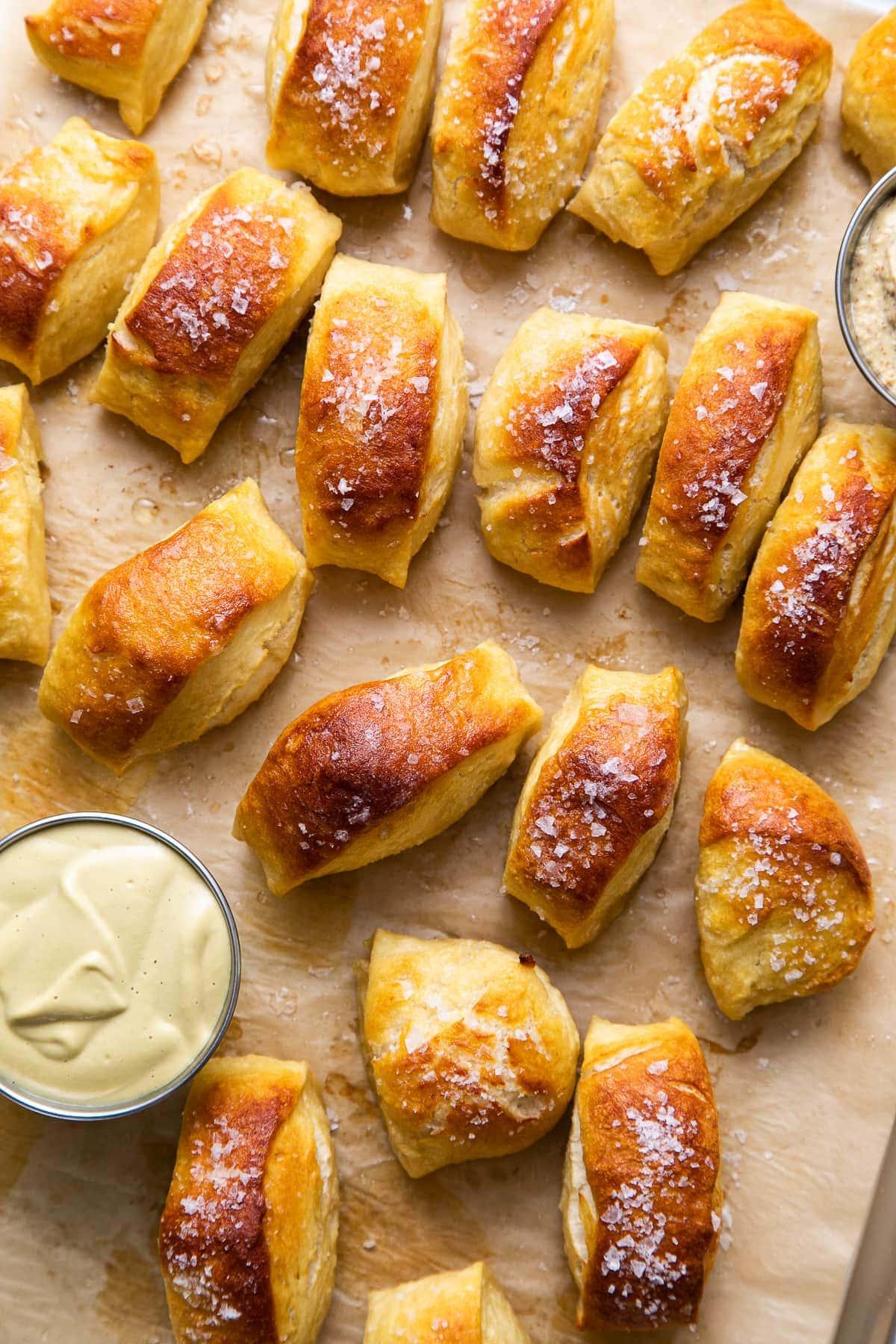 top down view of freshly baked vegan soft pretzel bites on a baking sheet.