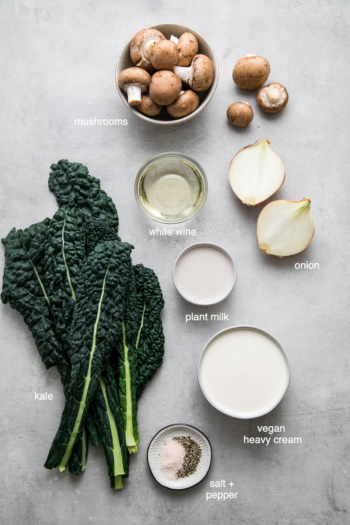 top down view of ingredients used to make kale and mushroom gratin.