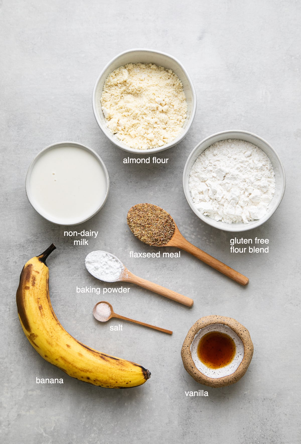 top down view of ingredients needed to make the best vegan gluten free pancakes with almond flour and banana.